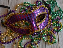 Mardi Gras Mask With Beads On A Wood Background Stock Photos