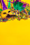 Mardi Gras Mask on yellow Background stock images