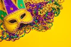 Mardi Gras Mask on yellow Background Stock Photos