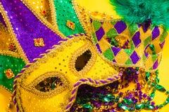 Mardi Gras Mask on yellow Background. A venetian, mardi gras mask or disguise on a yellow background