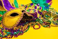Mardi Gras Mask on yellow Background Royalty Free Stock Photos