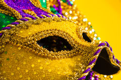 Mardi Gras Mask on yellow Background royalty free stock image