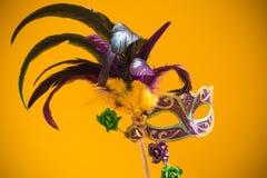 Mardi Gras Mask on yellow Background Royalty Free Stock Photo