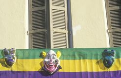 Mardi Gras Masks on Balcony of  Building, New Orleans, Louisiana Royalty Free Stock Images