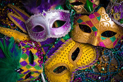 Mardi Gras Masks with beads. A group of venetian, mardi gras mask or disguise on a dark background