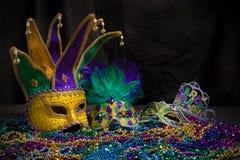 Mardi Gras Masks på mörk bakgrund royaltyfri foto