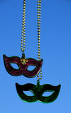 Mardi Gras masks. A pair of decorative masks hang freely to mark the celebration of Mardi Gras Stock Image