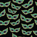 Mardi Gras masks seamless pattern. Cartoon doodle background. Vector illustration royalty free illustration