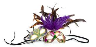 Mardi gras masks on a white background. Purple, green and gold mardi gras masks on a white background