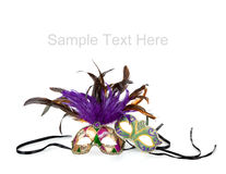 Mardi gras masks on white with copy space. Purple, green and gold mardi gras masks on a white background with copy space