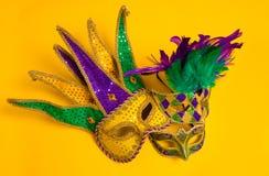 Mardi Gras Masks on yellow Background Royalty Free Stock Photos
