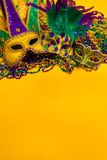 Mardi Gras Masks on yellow Background Stock Images