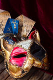 Mardi gras masques. Pair of venetian Mardi gras masques of cat and harlequin Royalty Free Stock Photo