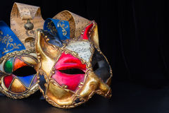 Mardi gras masques. Pair of venetian Mardi gras masques of cat and jester Royalty Free Stock Photo