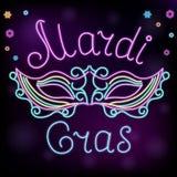Mardi Gras Neonmaskendekoration zum Faschingsdienstag Stockfotos