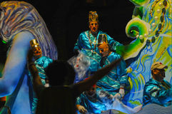 Mardi Gras night parade. Masked and costume krewe members aboard a parade float on St Charles during Mardi Gras in New Orleans, Louisiana Stock Images