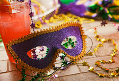 Mardi Gras: Party Mask Sits Against Tropical Hurricane Cocktail Stock Image