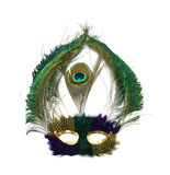 Mardi Gras peacock mask. A Mardi Gras mask with stunning peacock feathers and gold sequins around eye holes