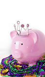 Mardi Gras Pig. Gy pank on a pile of Mardi Gras beads and coins Stock Photo