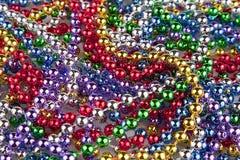 Mardi Gras pryder med pärlor royaltyfri bild