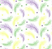 Mardi Gras seamless pattern with feathers purple, yellow, green color. Fat Tuesday repetitive texture. Carnival endless stock image