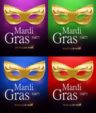 Mardi Gras set of golden carnival masks with ornaments for poster, greeting card, party invitation, banner or flyer on beautiful r. Ed, green, purple and blue Stock Photos