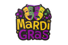 Mardi Gras. A Mardi Gras sign aginast a white background