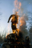 Mardi gras winter effigy in spring fire Stock Photo