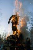 Mardi gras winter effigy in spring fire. Mardi gras winter jackstraw effigy in spring fire Stock Photo