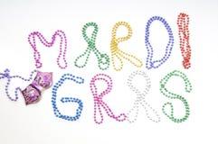 Mardi gras written in beads Royalty Free Stock Photo