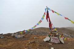 Mardi Himal Base Camp in Nepal, Annapurna region. Prayer flags. Mardi Himal Base Camp in Nepal, Annapurna region. Prayer flags in fog royalty free stock images