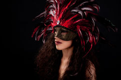 Mardi Mask. Beautiful model wearing a feather mask symbolizing mardi gras or venetian carnival Stock Photo
