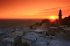 Mardin;Mesopotamia and Sunset. Mardin settled on hill of a mountain is one of the oldest cities of north Mesopotamia in southeast of Turkey. Mardin, having a Stock Photos