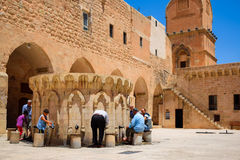 Mardin, Turkey-July 6, 2015: Muslim people are preparing themselves for prayer. Mardin, Turkey-July 6, 2015: Muslim people are washing their hands and feet Royalty Free Stock Image