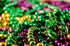 Mardis Gras Beads. A colorful pile of Mardis Gras beads and a toy crawfish Stock Photos