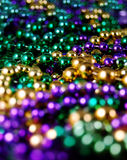 Mardis Gras Beads. A sea of Mardis Gras beads with defocused foreground Stock Images