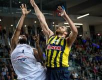 Mardy Collins a Oguz SavaÅŸ. LUBIN 23/10/2014 _ 2nd round Euroleague basketball match between the PGE Turow Zgorzelec and Fenerbahce Ülker Istanbul royalty free stock photos