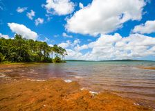 Landscape of water reservoir in Mauritius island. Mare aux Vacoas - is the largest water reservoir in Mauritius island. Landscape view from the west shore Royalty Free Stock Images