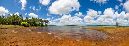 Landscape of water reservoir in Mauritius island. Mare aux Vacoas - is the largest water reservoir in Mauritius island. Landscape view from the west shore Royalty Free Stock Photography
