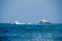 Mare. Boat in the sea near the island stock photography