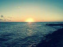 Mare della spiaggia di tramonto Fotografia Stock