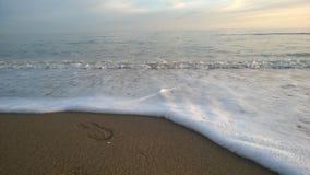 Mare nel tramonto Immagine Stock