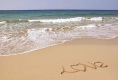 Mare, sabbia ed amore Fotografie Stock Libere da Diritti