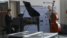 Marek Jakubowski trio on the rehearsal. Novosibirsk, Russia - October 23, 2014: Adam Bieranowski at the piano and Damian Kostka at the bass on the sound-check stock footage