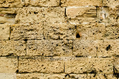 Mares sandstone stone masonry wall in Majorca Royalty Free Stock Images