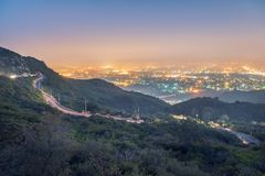 Margalla Hill Islamabad Pakistan. A winding road on a margalla  mountain being lit up at night, Islamabad, Pakistan Royalty Free Stock Image