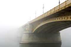 Margaret Bridge Budapest. The Margaret Bridge in Budapest in a typical autumnal foggy day Stock Photos