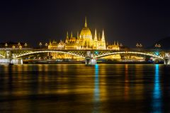 Margaret bridge and Parliament in Budapest royalty free stock photo
