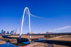 Margaret Hunt Hill Bridge with Dallas skyline in the background stock photos