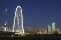 The Margaret Hunt Hill Bridge and Downtown Dallas at night in Texas